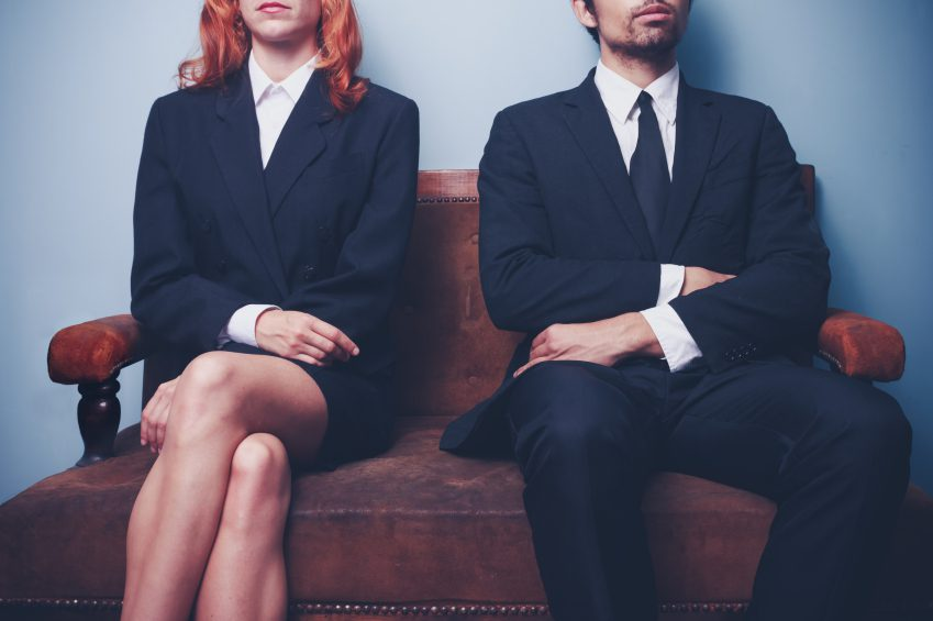 Man and woman waiting to see divorce lawer